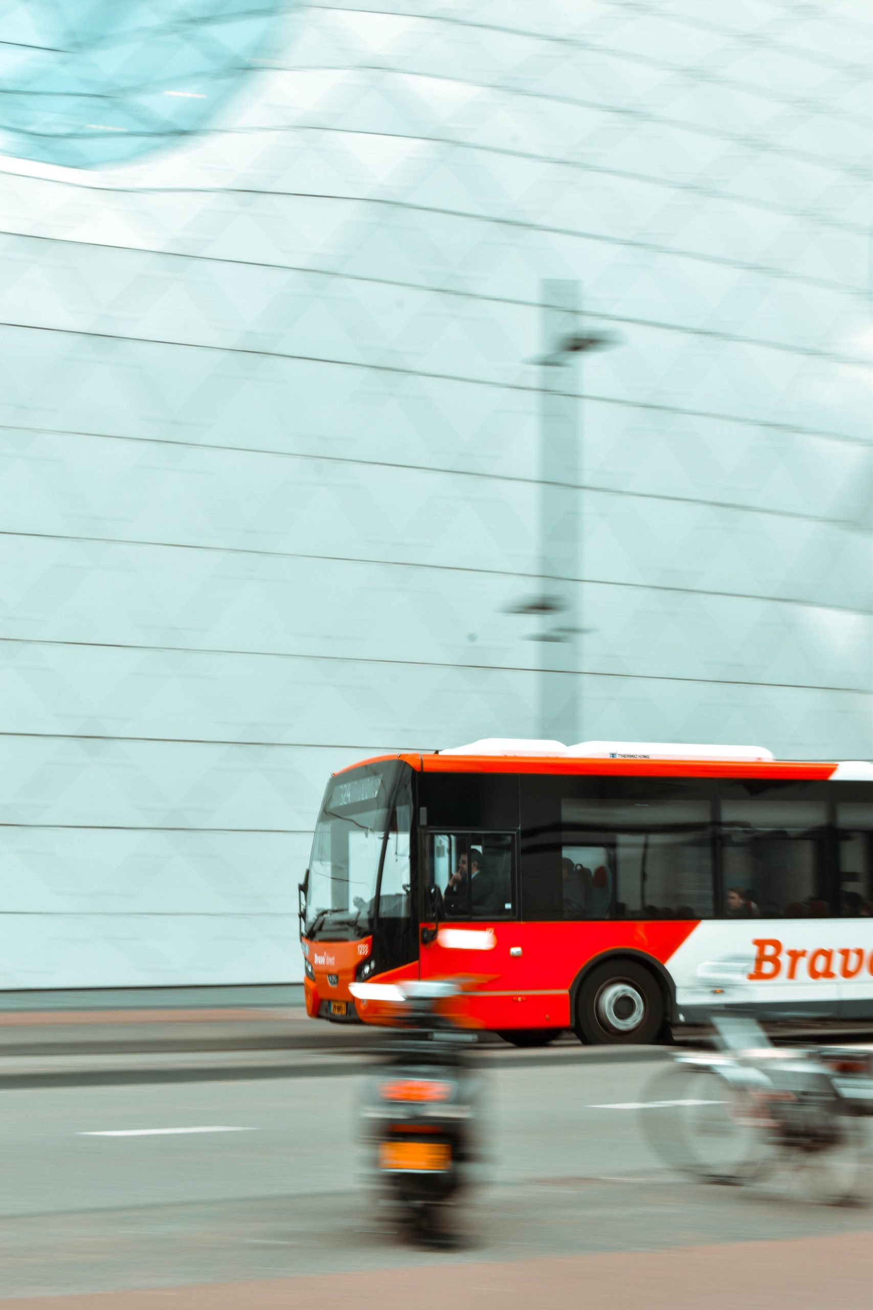 selective-focus-photography-of-red-and-white-bus-2085503