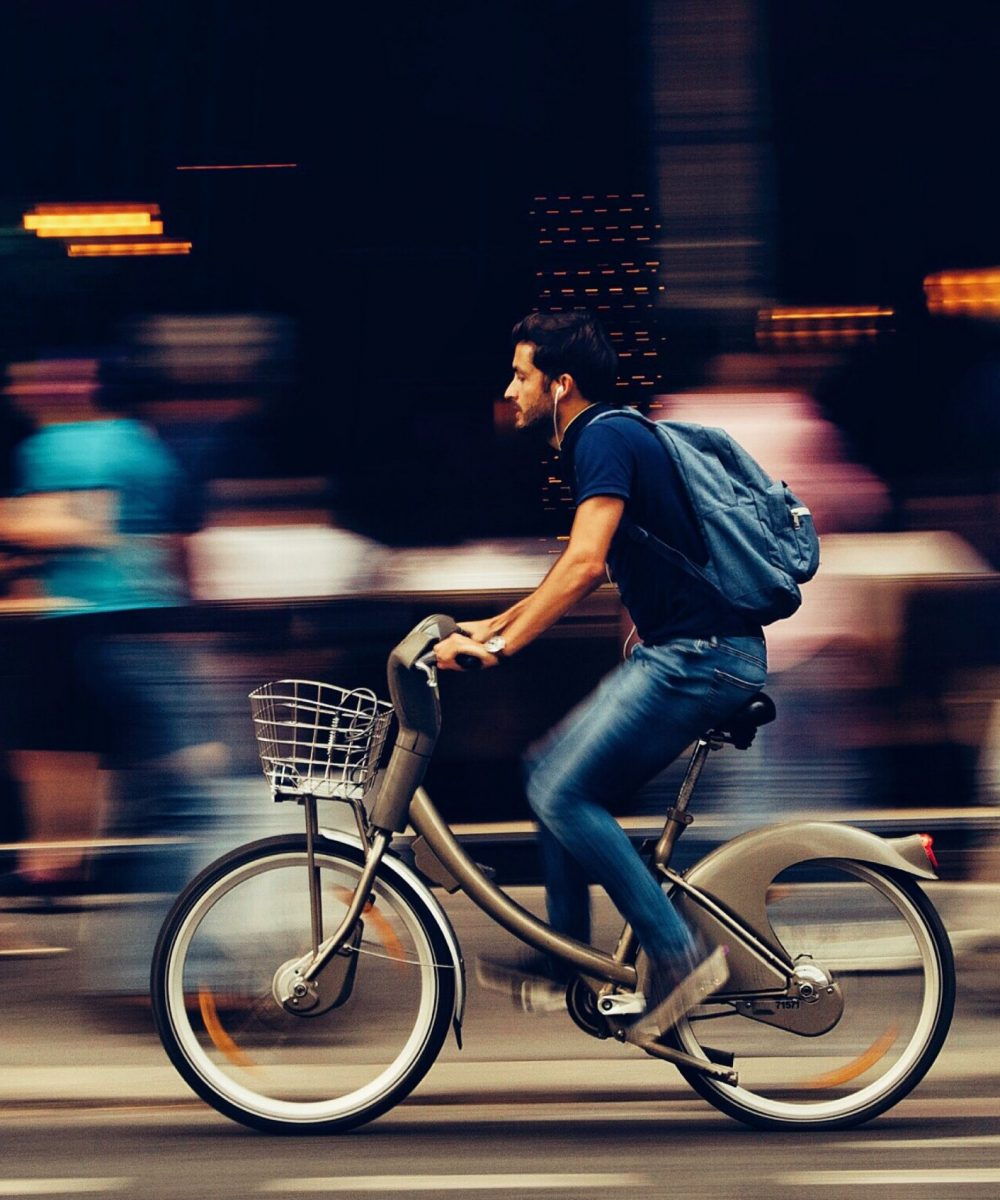 man-riding-bicycle-on-city-street-310983